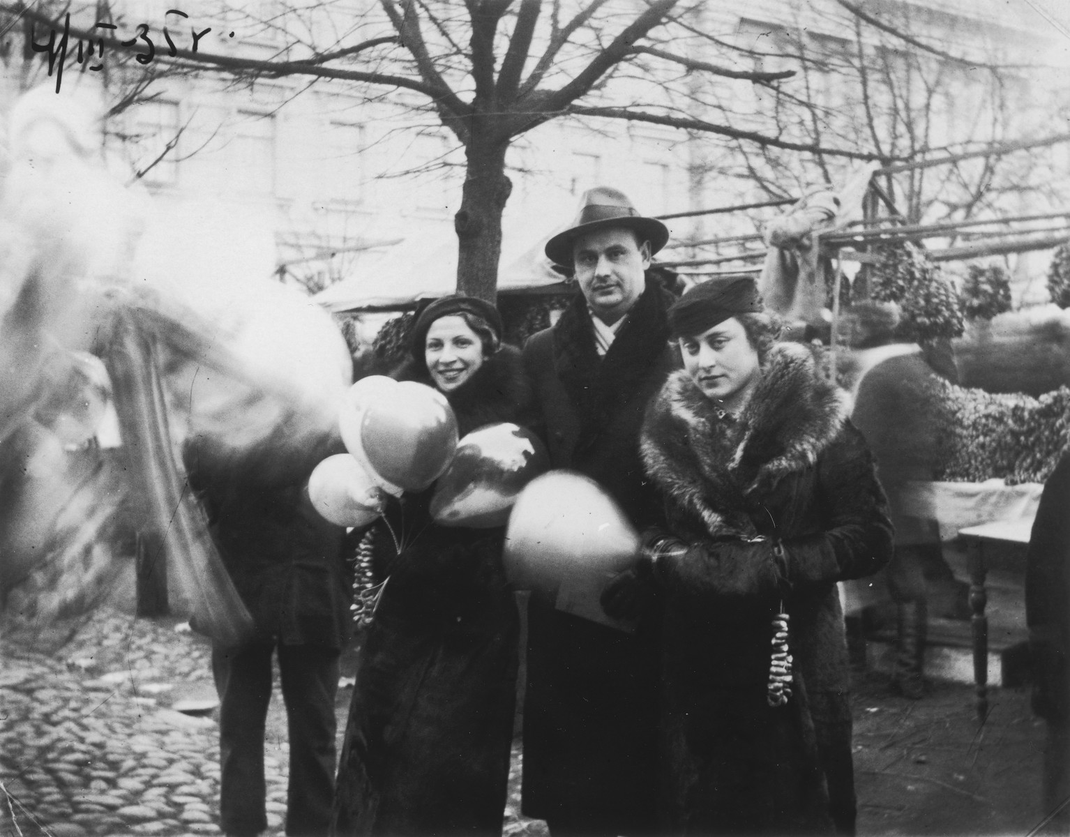 Two Jewish women visit the outdoor mushroom market in Vilna.  Raya Markon is pictured on the left; Raya Lewin is on the right.