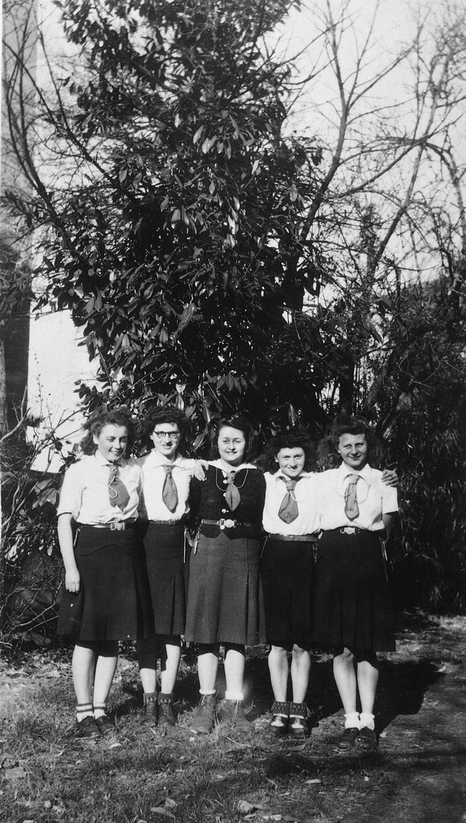 Portrait of five girl scouts in France shortly after liberation; two are Jewish sisters who had survived in hiding.  Helene Steinberg is second from the right; her sister Rose is second from the left.