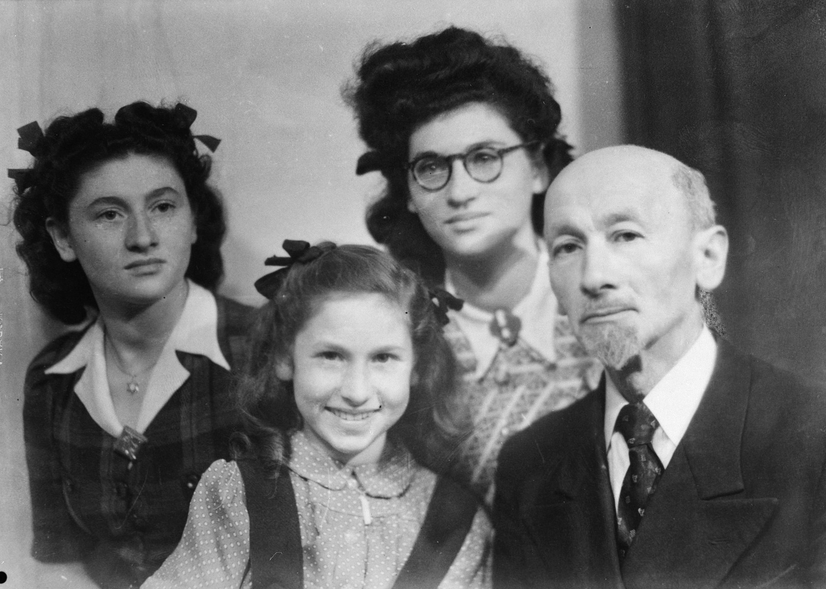 Studio portrait of a Jewish family in Metz after the war.  From left to right are Helene, Rivke, Rose and Eliezer Steinberg.
