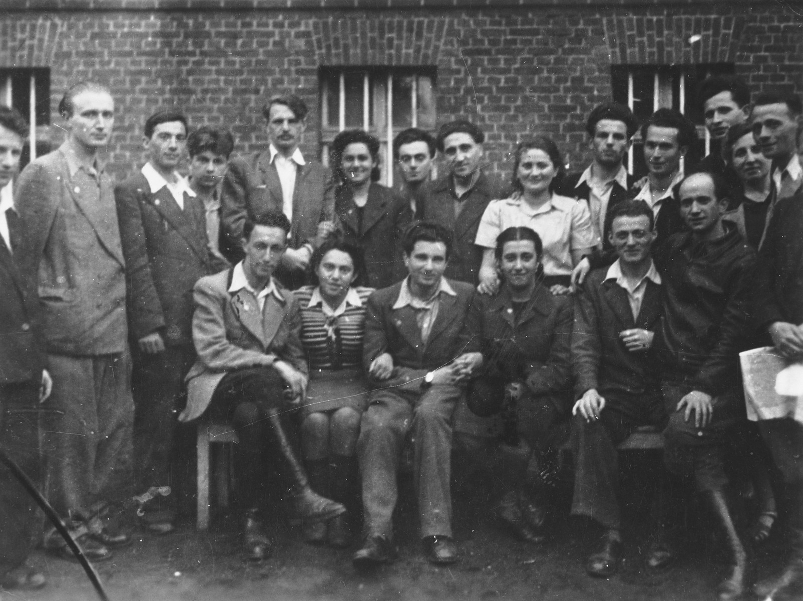 Group portrait of members of the Zionist group, Dror, in the Rosenheim displaced persons' camp.  Yitzchak (Antek) Zuckerman is standing in the back, fifth from the left.  Next to him is Fira Scapinker.
