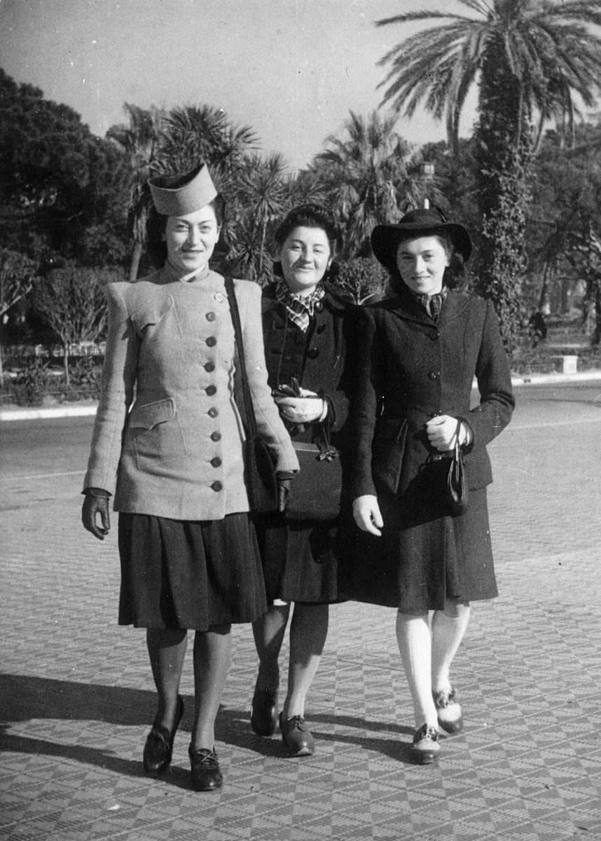 Three Jewish women in hiding prepare to go to the wedding of their older brother in Nice.  From left to right are Annie, Adele and Helene Steinberg.