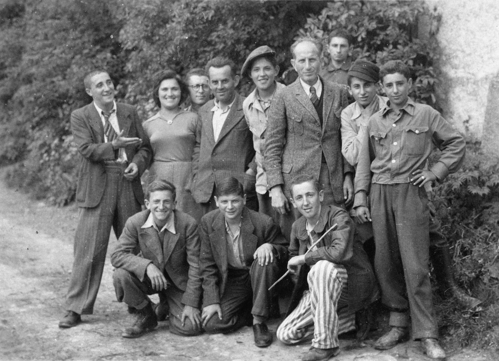 Group portrait of survivors of a Kaufering sub-camp one month after liberation.  Among those pictured are Uriel Hanoch (standing fifth from the left).