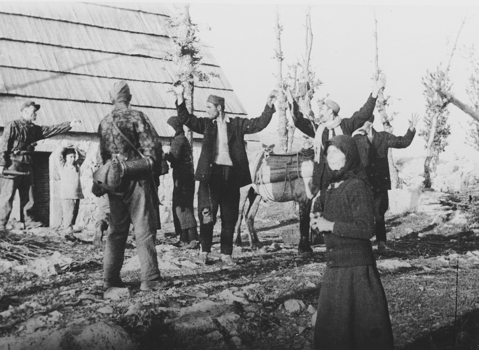 "Croation partisans surrender to German soldiers.   The original  Waffen-SS caption reads ""Gefangene Partisanen"" (catched partisans)."