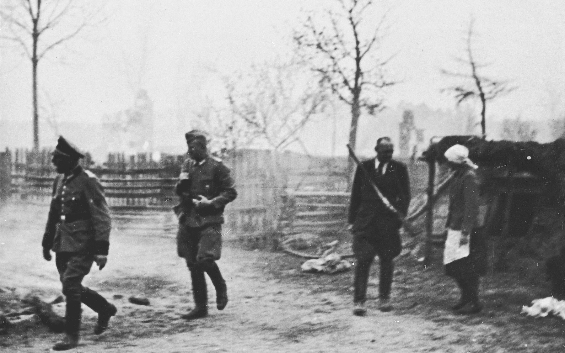 """Officers with the 1st Motorized Police Battalion in Michniow during the """"pacification"""" of the village."""
