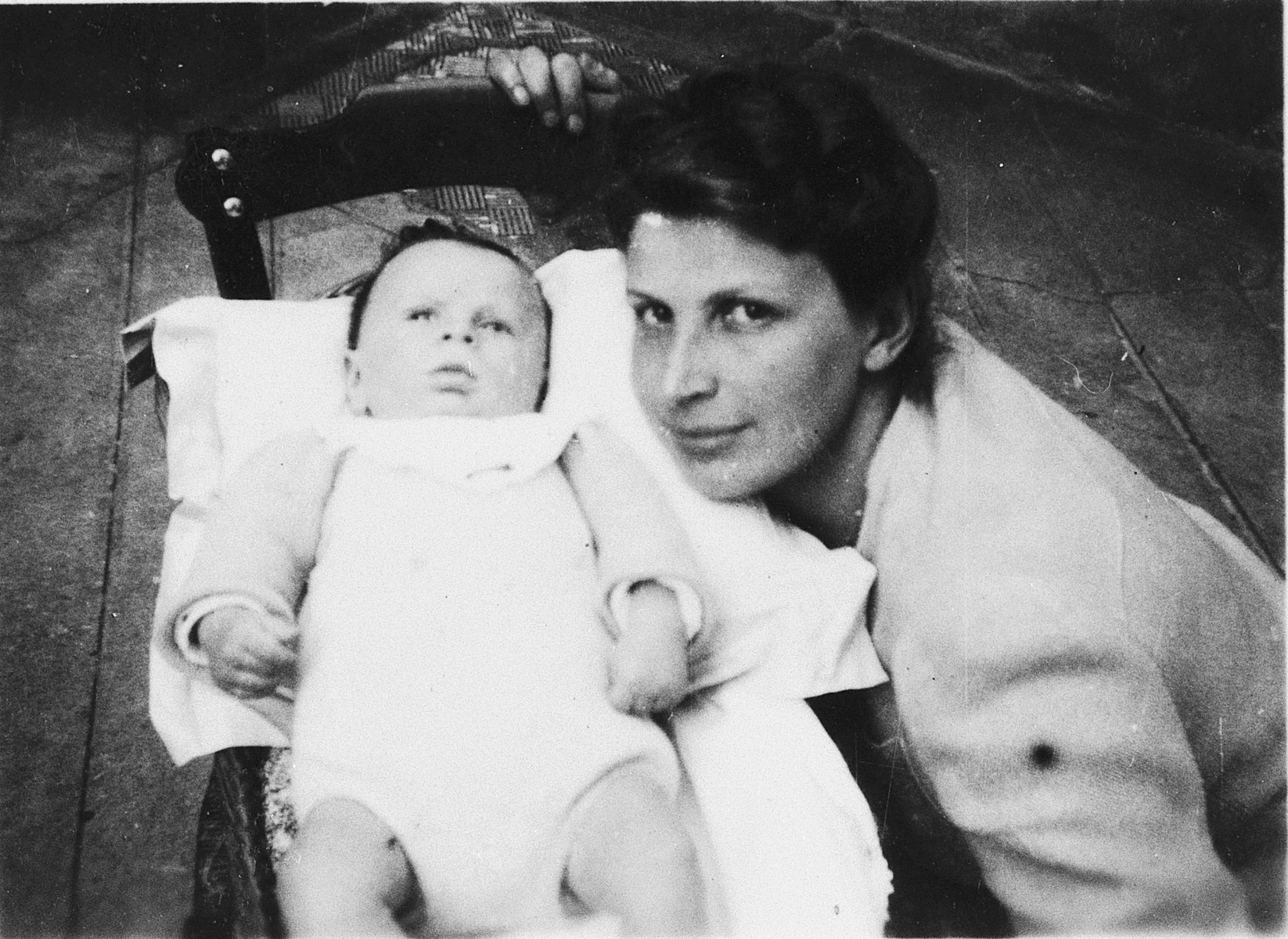 Raya Markon poses next to her infant son, Alain, in Toulouse.