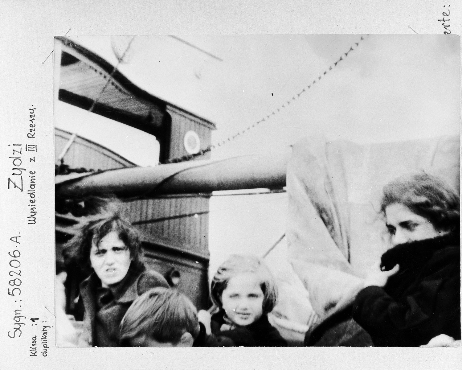A group of German-Jewish refugee women and children aboard a Greek vessel [the Aghia Dezioni] on their way to Palestine.    One hundred seventy  Jewish refugees came to Fiume, Italy and were placed aboard a small Greek coastal steamer. Their passports contained visas for China. However, when the ship reached the open sea, their passports were forcibly taken and thrown into the sea. The refugees were told they would disembark in Palestine. After 36 days of floundering in the eastern Mediterranean and severe mistreatment aboard ship, 120 refugees managed to enter Palestine. There they were discovered by the British army and placed in the Sarafend camp for new immigrants.