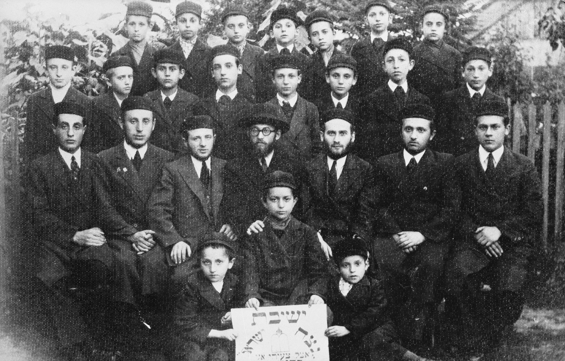 Group portrait of students and rabbis at the Netzach Yisrael Yeshiva in Bedzin.