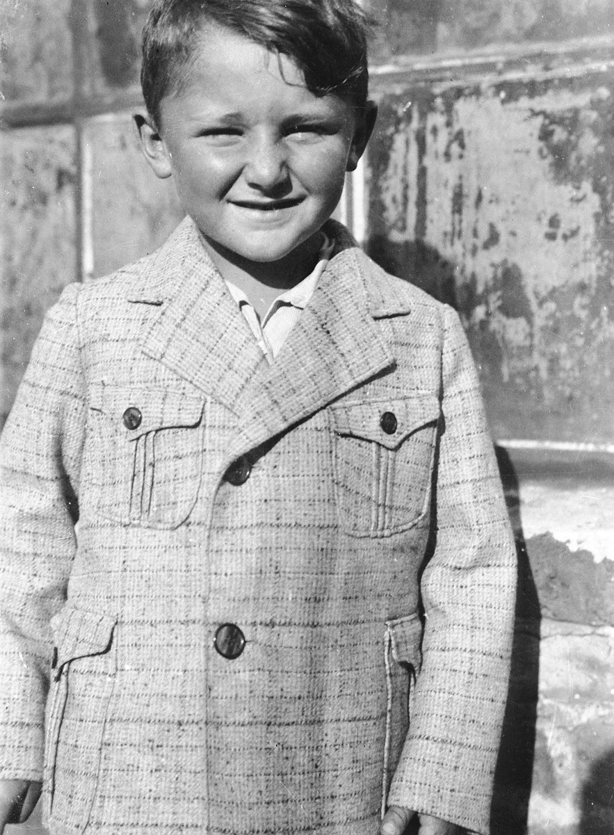 Portrait of a Jewish child, Pinchas (Piniek) Gutman, in Bedzin Poland.  Pinchas Gutman was the son of Sender and Estera (Werdygier) Gutman.  He had a younger sister, Ewa.  All four members of the family were deported to Auschwitz in August 1943, where they perished.  Pinchas was the cousin of the donor, Hadasa Werdygier.