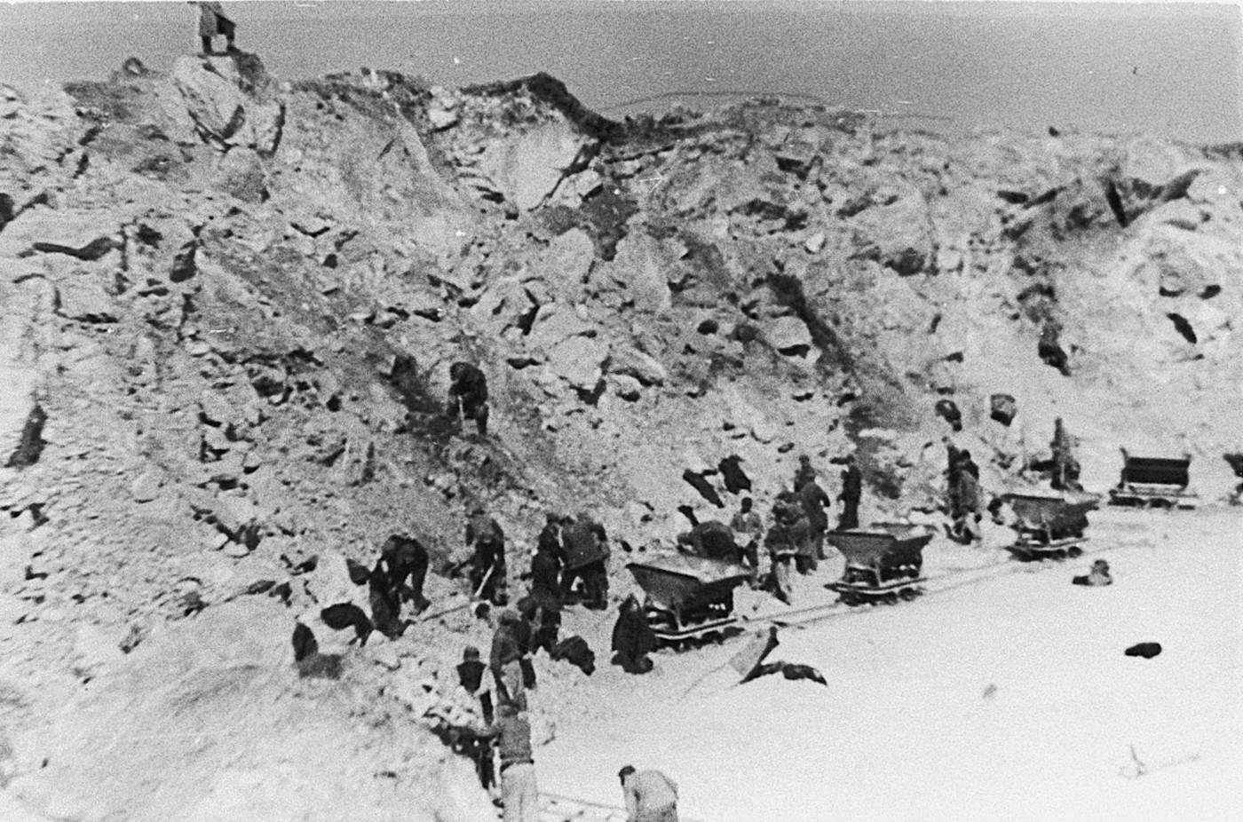 Jewish prisoners from the Stupki labor camp at forced labor in a quarry.   Stupki was one of several labor camps established along the route of the Rollbahn Sued in Galicia.