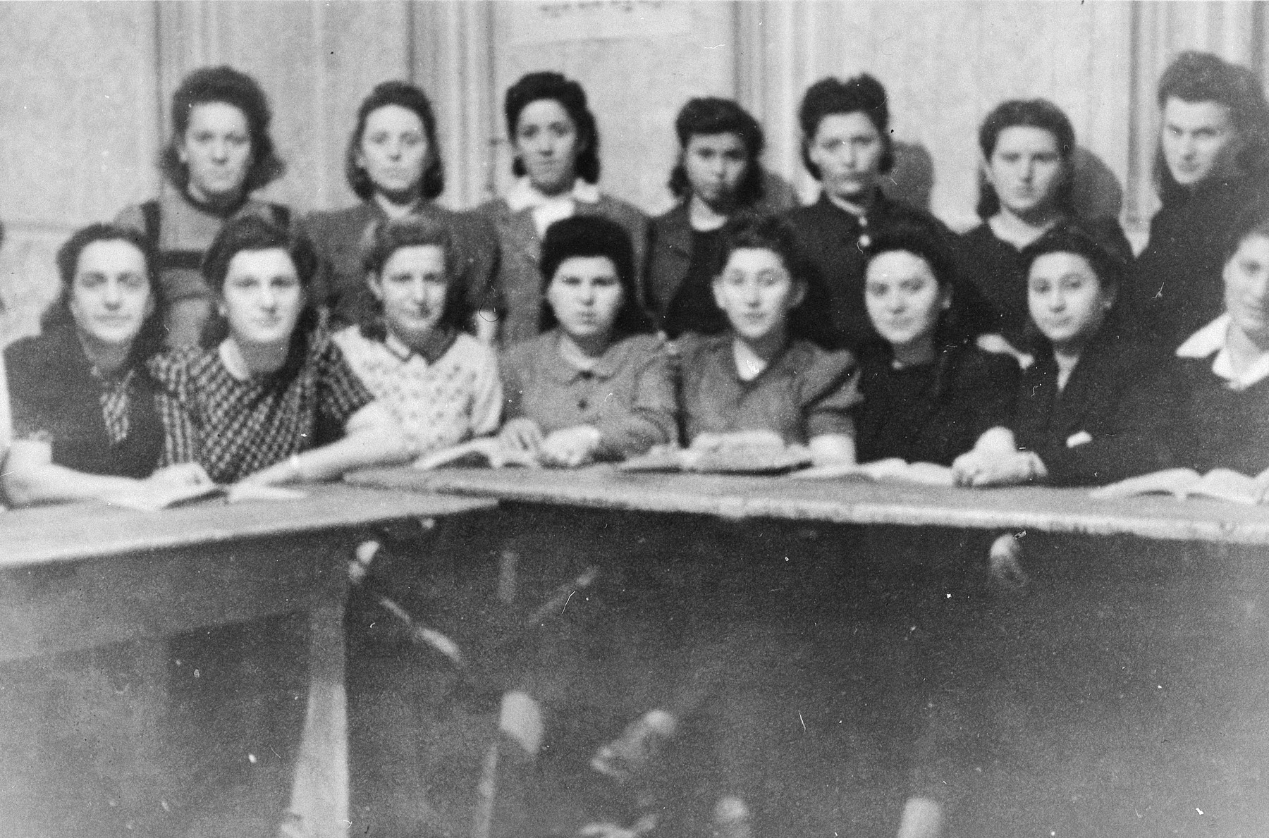 Girls belonging to the religious Mizrachi Zionist youth movement study Torah in the Ziegenhain displaced persons' camp.