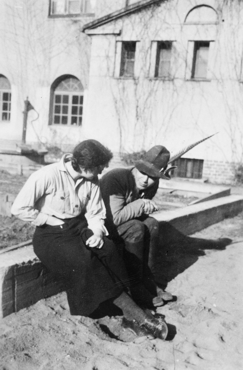 """Two young people from the Gross Breesen agricultural center talk outside during a break.   The original German caption reads: """"Short  work breaks, big questions."""""""
