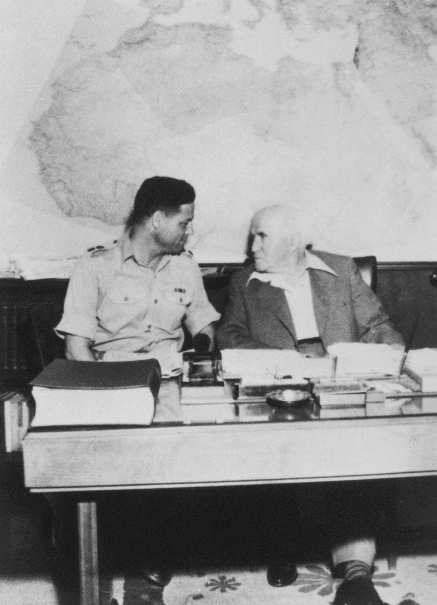 Prime Minister David Ben-Gurion confers with Navy Commander Yossi Harel.