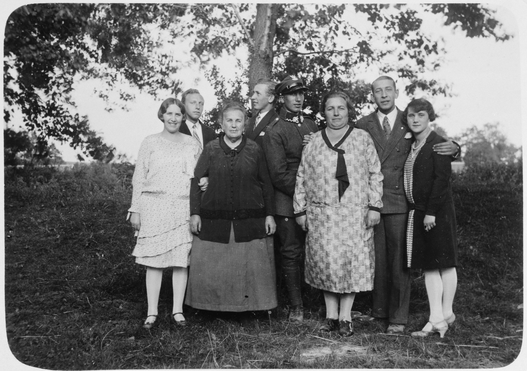 Portrait of an extended Jewish family and friends in prewar Krakow.  Fela Hoffman is pictured third from the left.  Also pictured are Wiktor Hoffman (probably fourth from the left) and his brother.