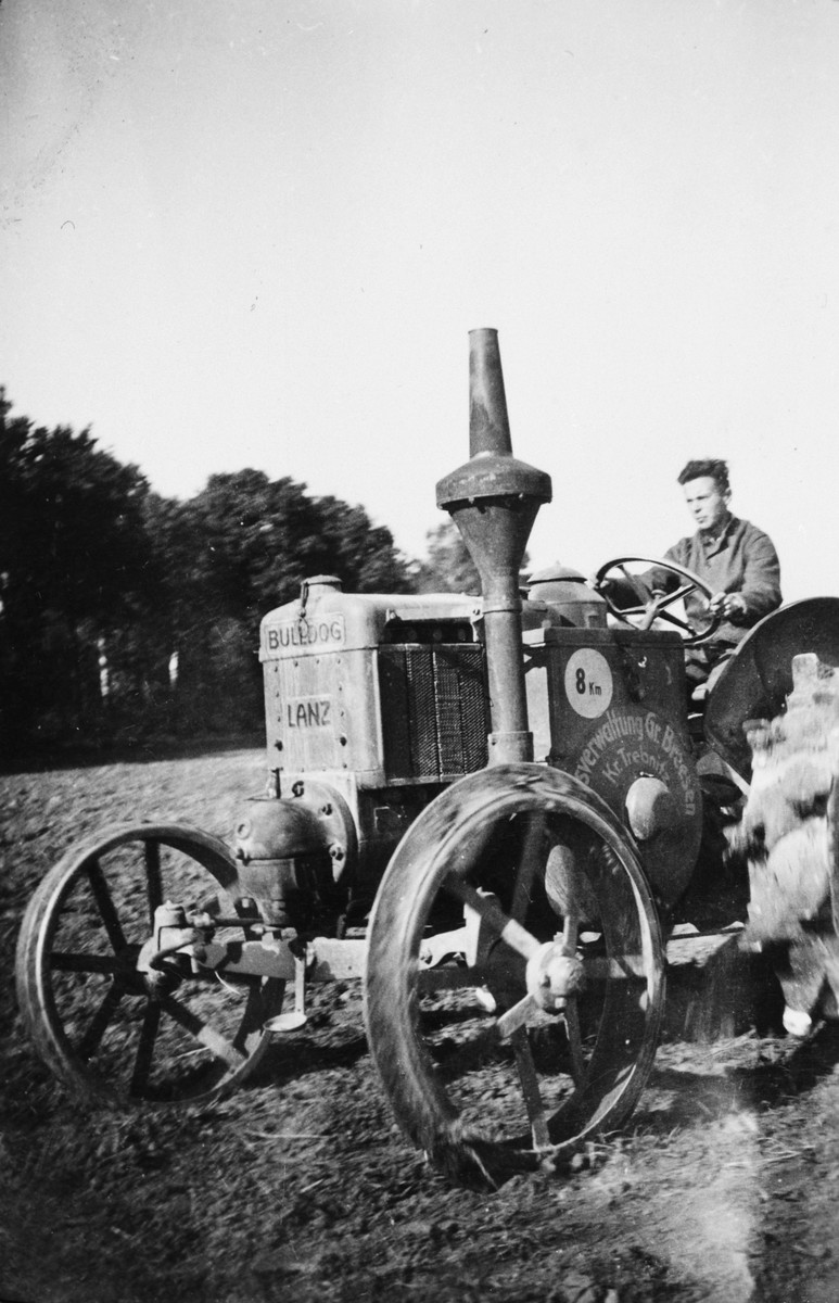 A German Jew drives a tractor in a training farm outside of Breslau.