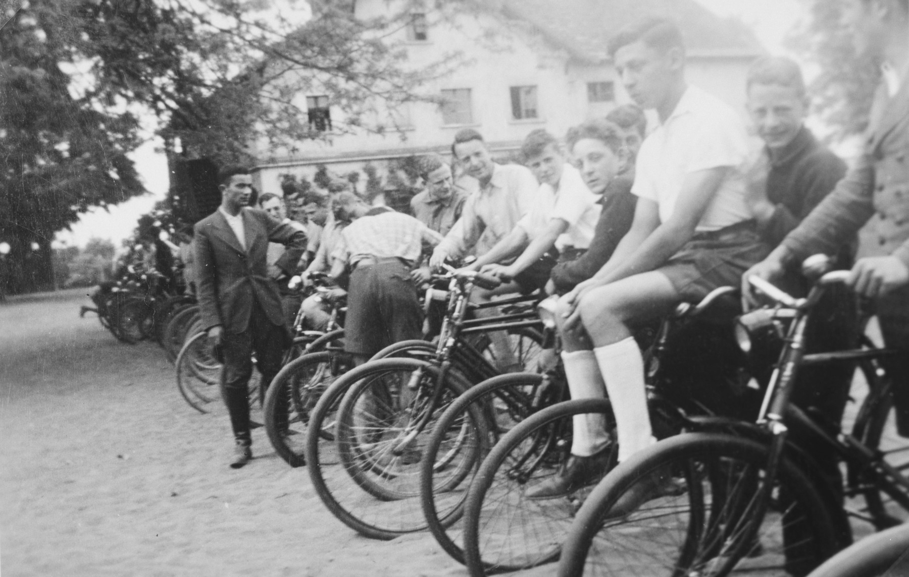 Jewish youth from a training farm outside of Breslau stand in line on bicycles before a raise or an outing.