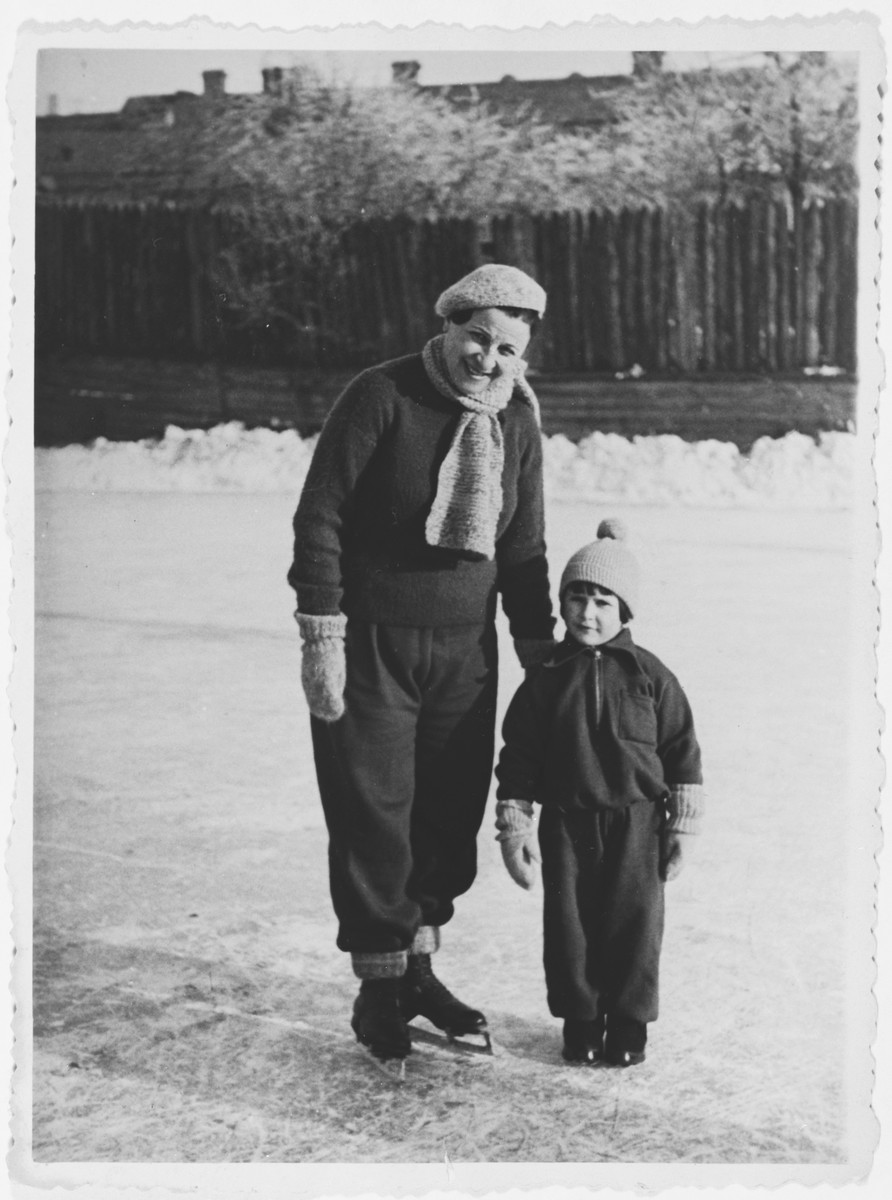 A Jewish mother and her son ice skating in Grodno, Poland.  Pictured are Estera Blumstein and her son Alexandre.