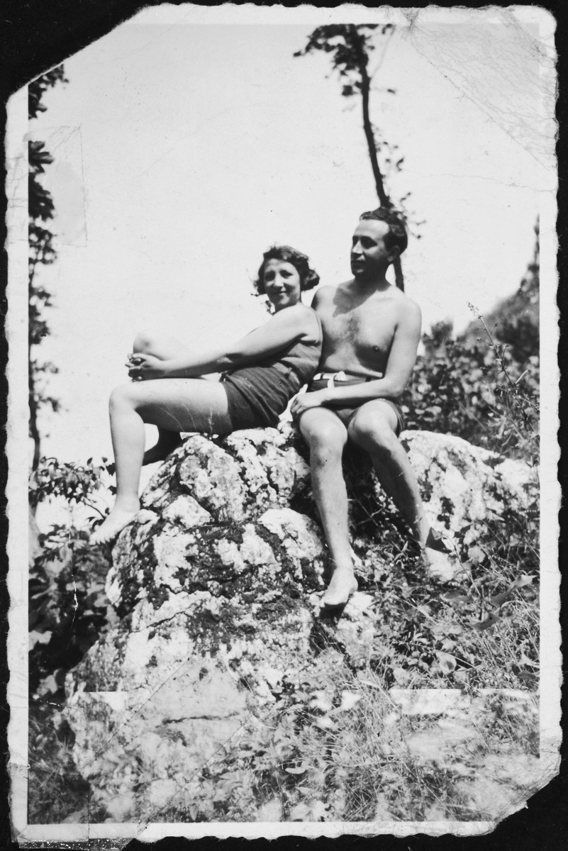 A Jewish couple sitting on a rock.  Pictured are Rita Blumstein's parents in late summer.