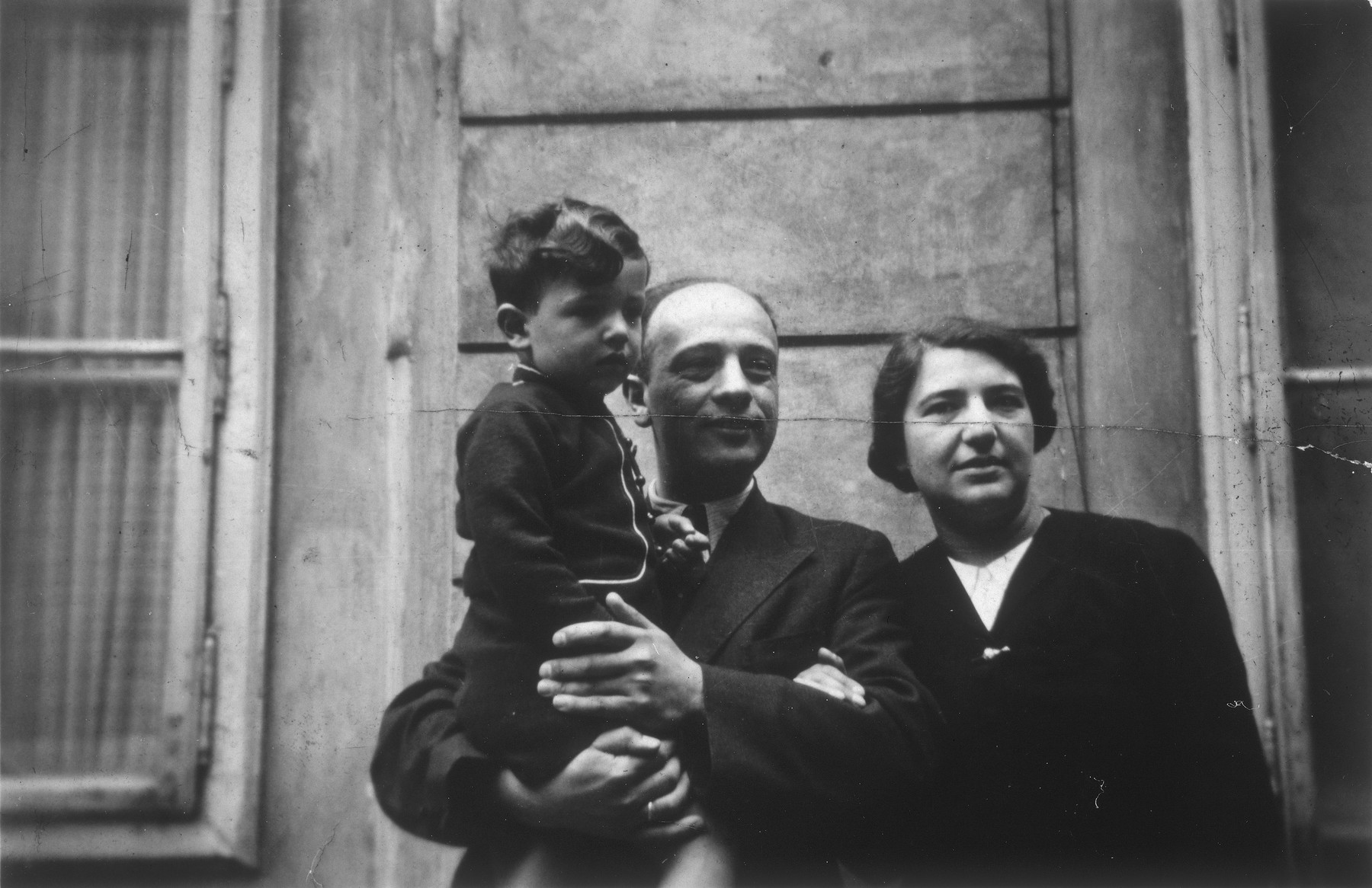 The Blumenstein family, [left to right] Heinz held by his father, Franz, who stands beside Elsa, his mother.