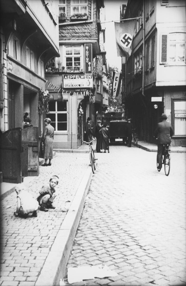 View of German street, with swatika flag hanging in upper left corner.