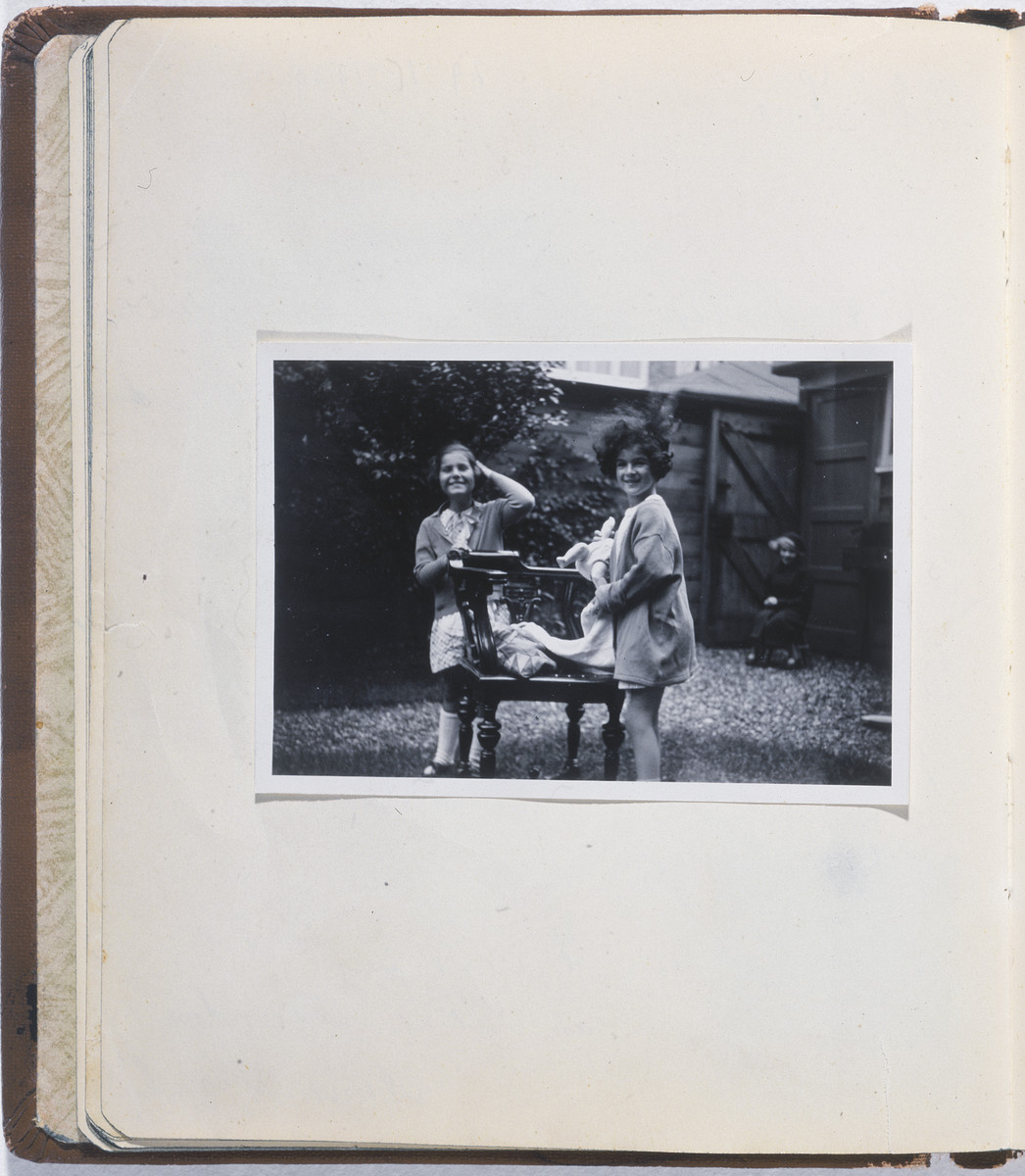 "One page from a ""Posie book"" or autograph album that belonged to Eva Goldberg Judd (donor's wife).  The page  features a photograph of  Eva Goldberg and Susanne Ledermann.  The album contains inscriptions from friends and family such as Anne Frank.  The contents of the autograph book were collected by Eva Goldberg prior to her emigration from Germany to the United States via the Netherlands and Great Britain."