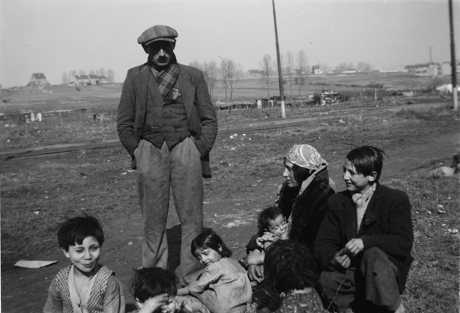 A Romani (Gypsy) family poses outdoors.