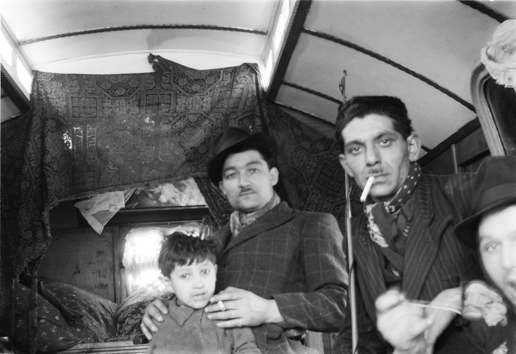 A Romani (Gypsy) family poses inside their caravan.