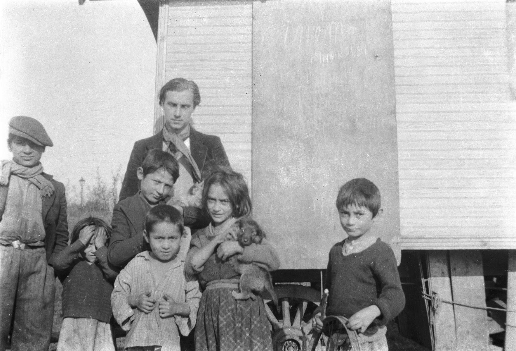 A group of Roma (Gypsy) children pose for a photograph, with Jan Yoors in center back.