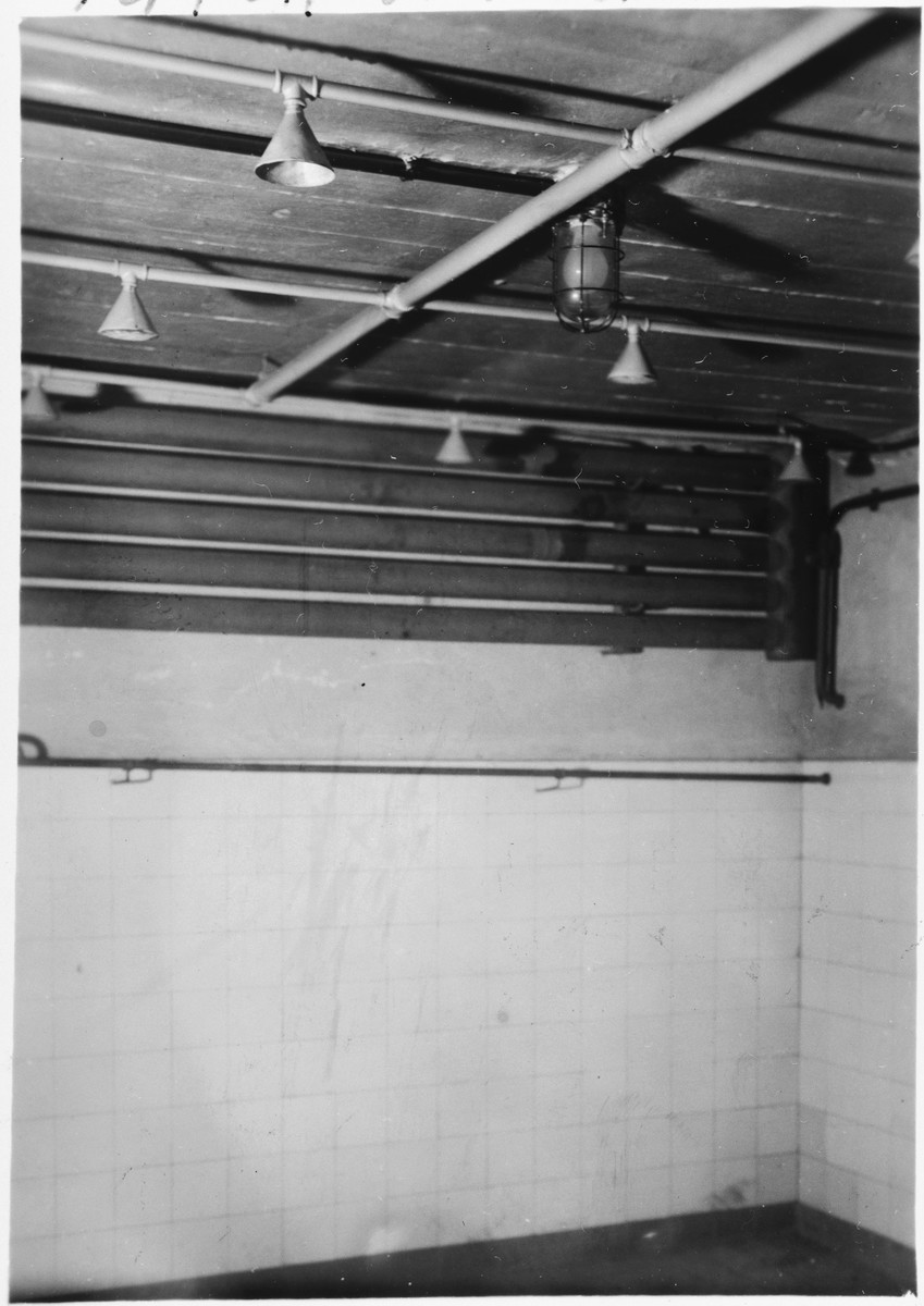 "Interior view of a gas chamber the Mauthausen concentration camp.  Original text reads: ""This is the gas chamber, note how it looks like a shower room. Camp Mauthausen. July 16th, 1945."""