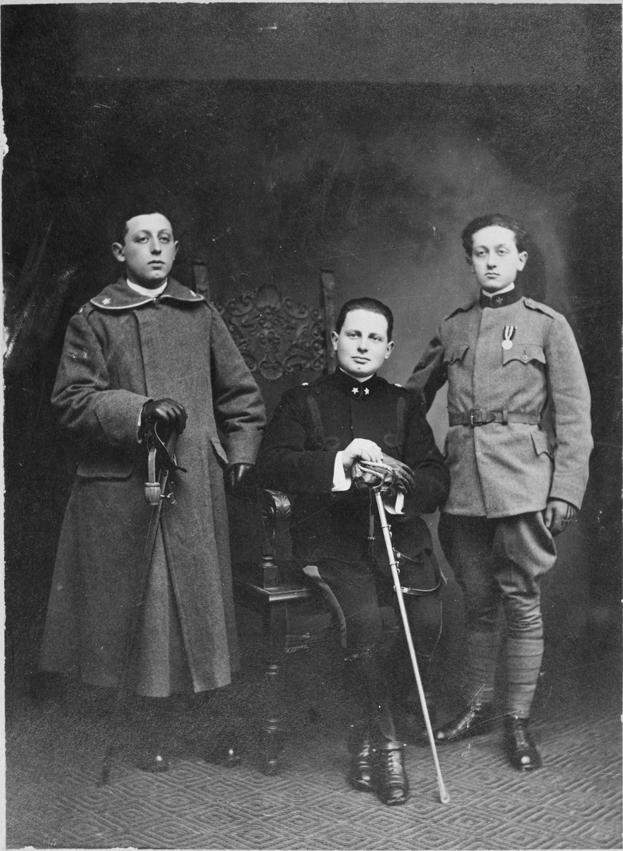 Studio portrait of Arturo Minerbi and two brothers in the Italian army in World War I.    Pictured on the left is Ivo and Leo on the right.