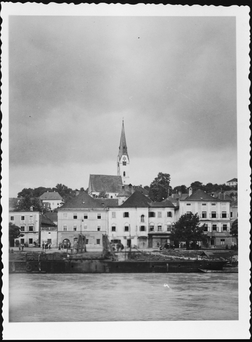 "View of the town of Mauthausen located on the river Danube.   Original caption reads: ""This is the town of Mauthausen. On the Danube. Note the bridge where the ferry ties up to. This town is about two miles from the Camp of Mauthausen. July 1945."""