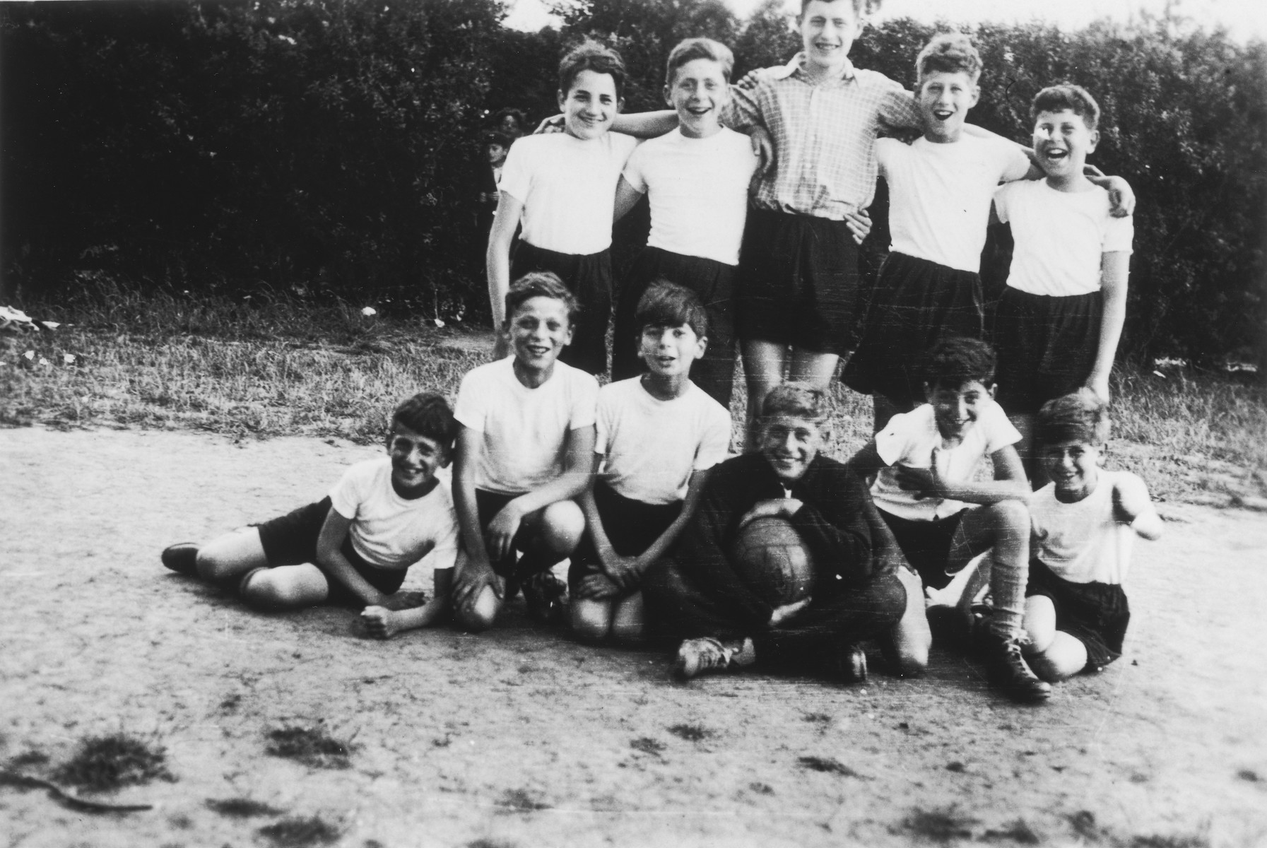 Group portrait of the members of the soccer team of the Rowden Hall School in Margate.    After the Dunkirk evaucation the children were evacuated to the Midlands, Staffordshire, Litchfield or Cannock Chase.   Among those pictured are Guenther Cahn (standing, far left) and Alfred Schwarzkopf (seated middle with the ball).  Fritz Weiss is seated third from the left.  Werner M. Rothschild is standing in the back row, far right.  [Seated on the left are possibly the brothers Cohen.]