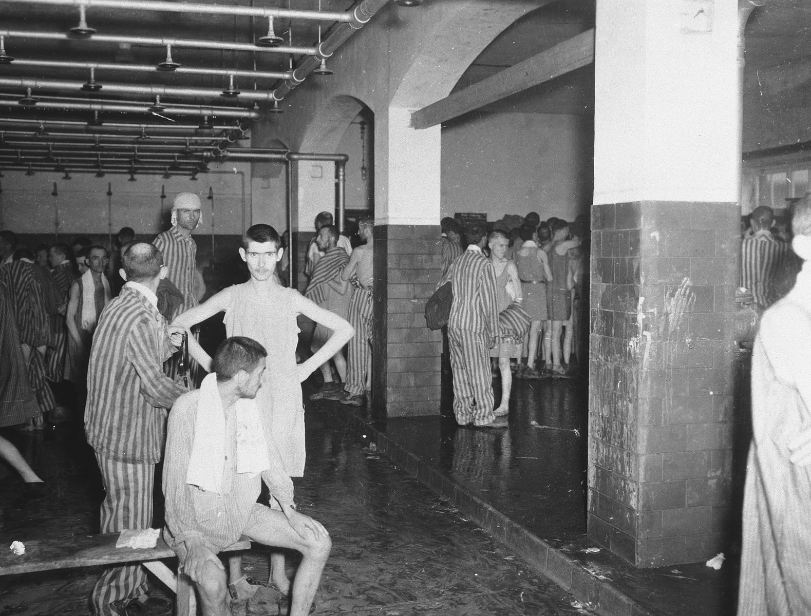 Survivors in the shower barracks after liberation.