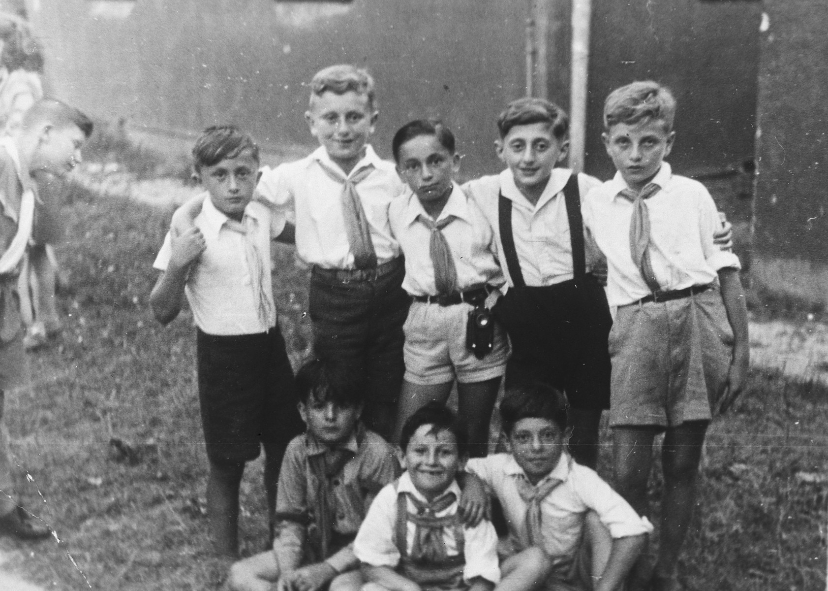 Group portrait of elementary school-age members of Hashomer Hatzair in the Stuttgart displaced persons camp.  Lova Warszawczyk is standing in the center.