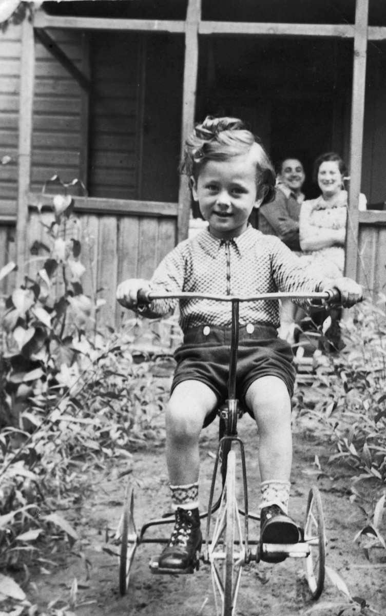 Lova Warszawczyk rides his tricycle in the garden of his home in Warsaw shortly before the start of World War II.