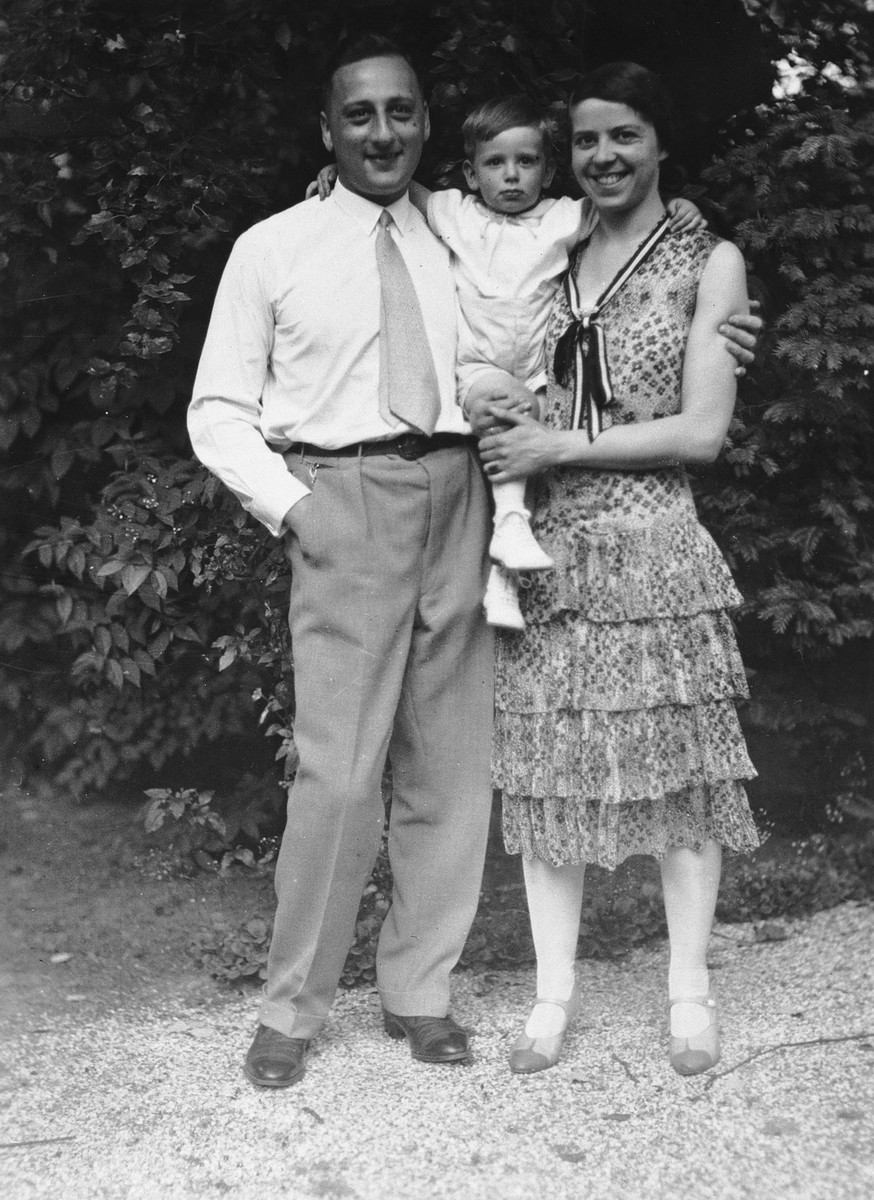A German-Jewish couple poses in a garden with their two-year-old son.  Pictured are Karl, Rolf, and Joahanna Blumenthal.