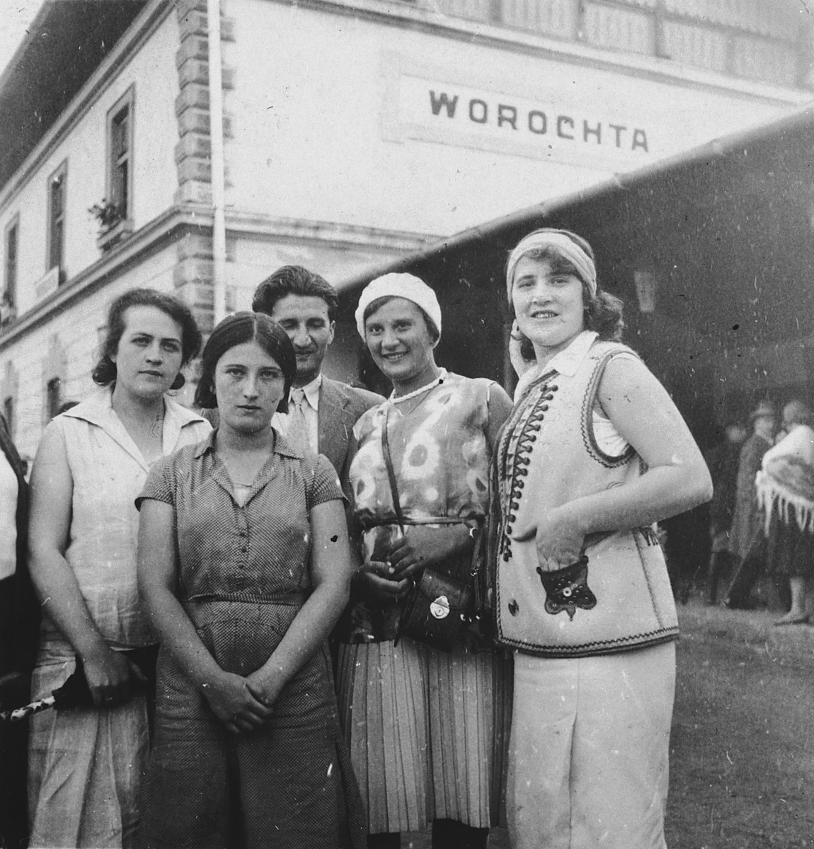 A group or friends and relatives gather outside a hotel in a mineral spa resort.  Among those pictured are Samuel and Sidonia Grunfeld, and Samuel's sister, Bertha.