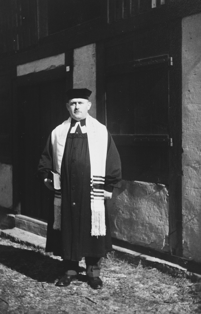 Close-up portrait of the cantor of the Breisach synagogue.  Pictured is Michael Eisemann, the last cantor and teacher of the Jewish community of Breisach.  This is part of series of photographs taken of the Breisach Jewish community 1937.  In October 1940 the entire community was deported to the Gurs internment camp in southern France.