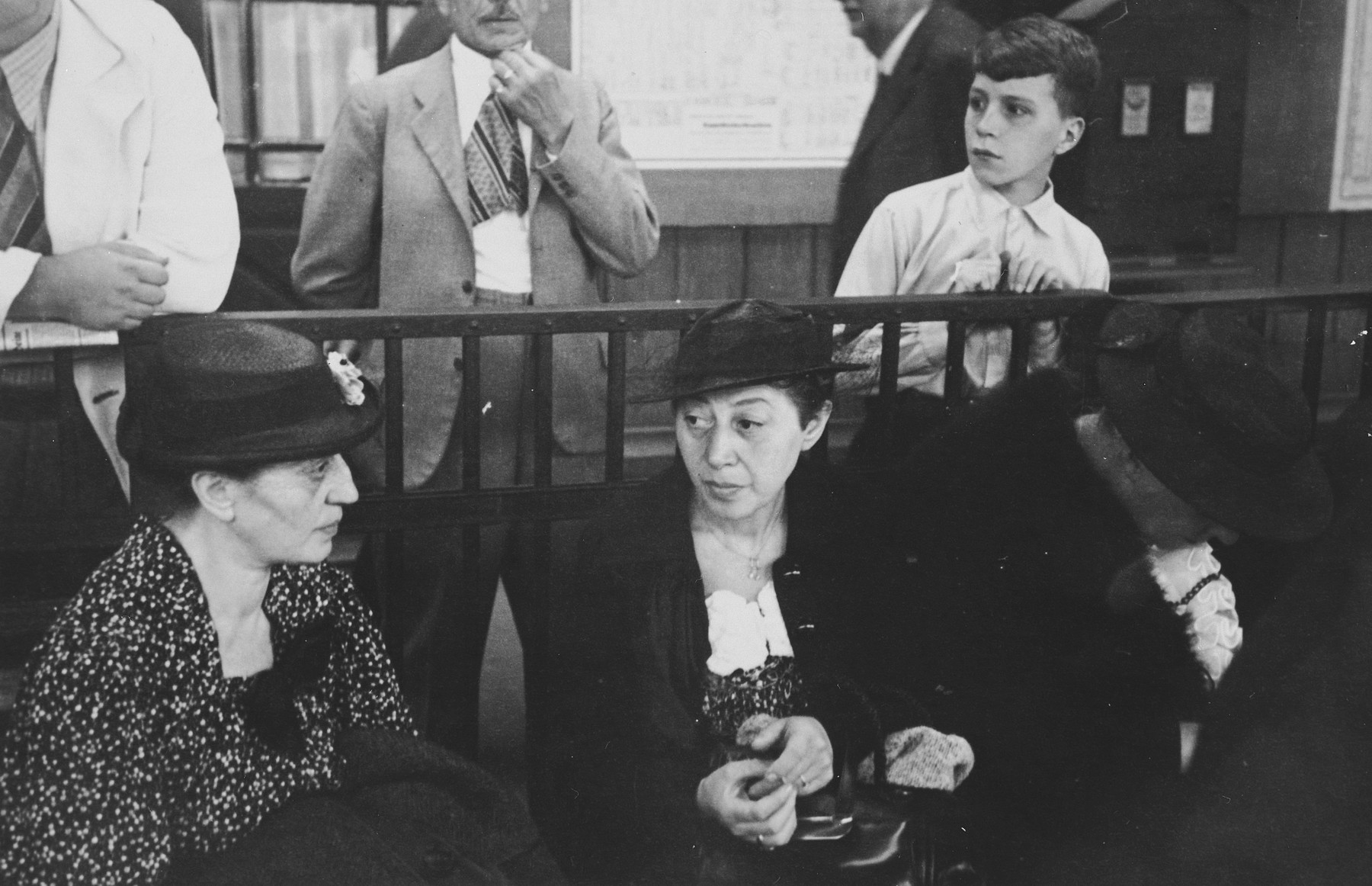 Two German Jewish sisters sit next to each other in a port while waiting for the departure of a ship.  Pictured are Fanny (left) and Talie (right) Bähr.  Talie and Julius are about to sail to New York to visit their son,  Dr. Heinz Bähr.