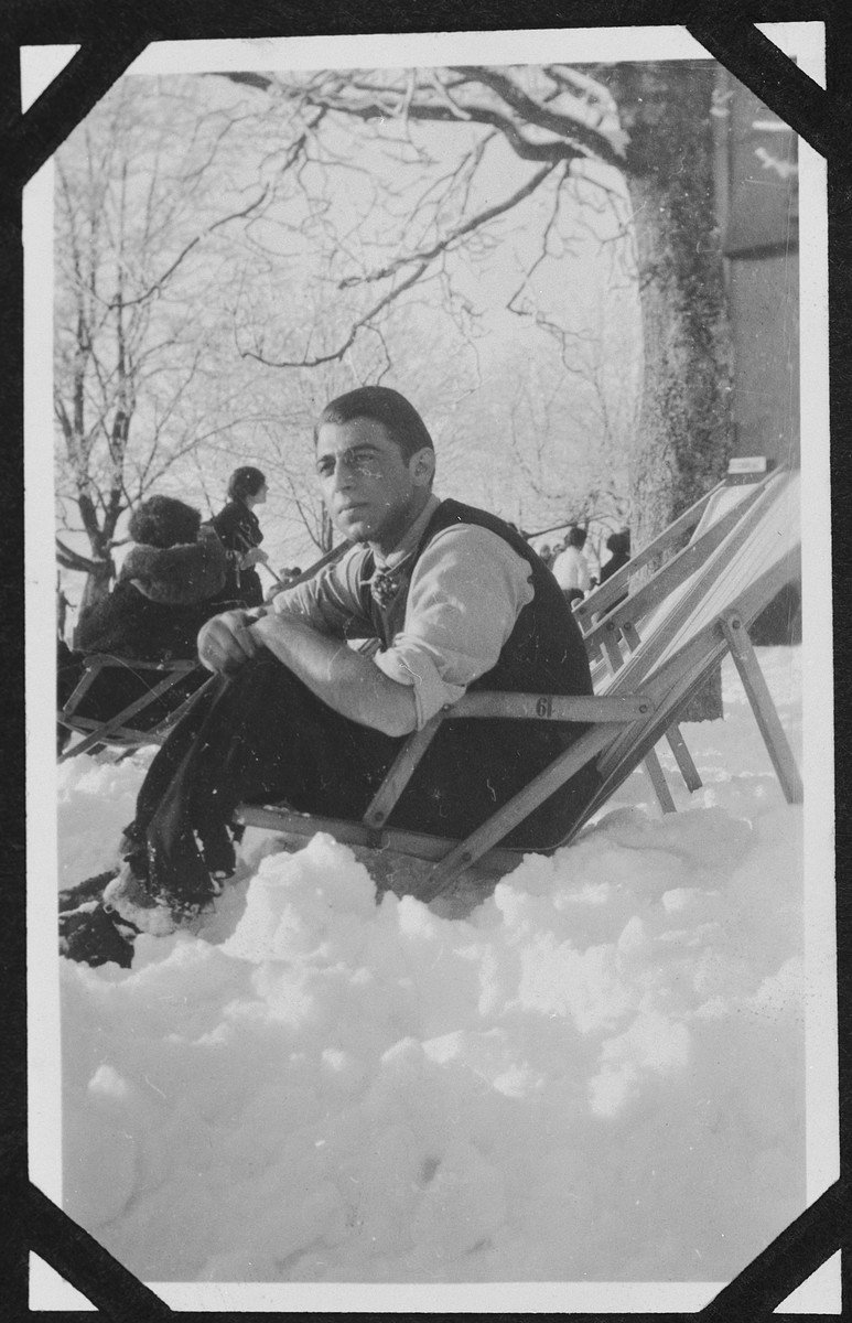 A young German-Jewish man rests on a deck chair in a snowy resort in Feldberg in the Black Forest.  Pictured is Heinz Bähr.