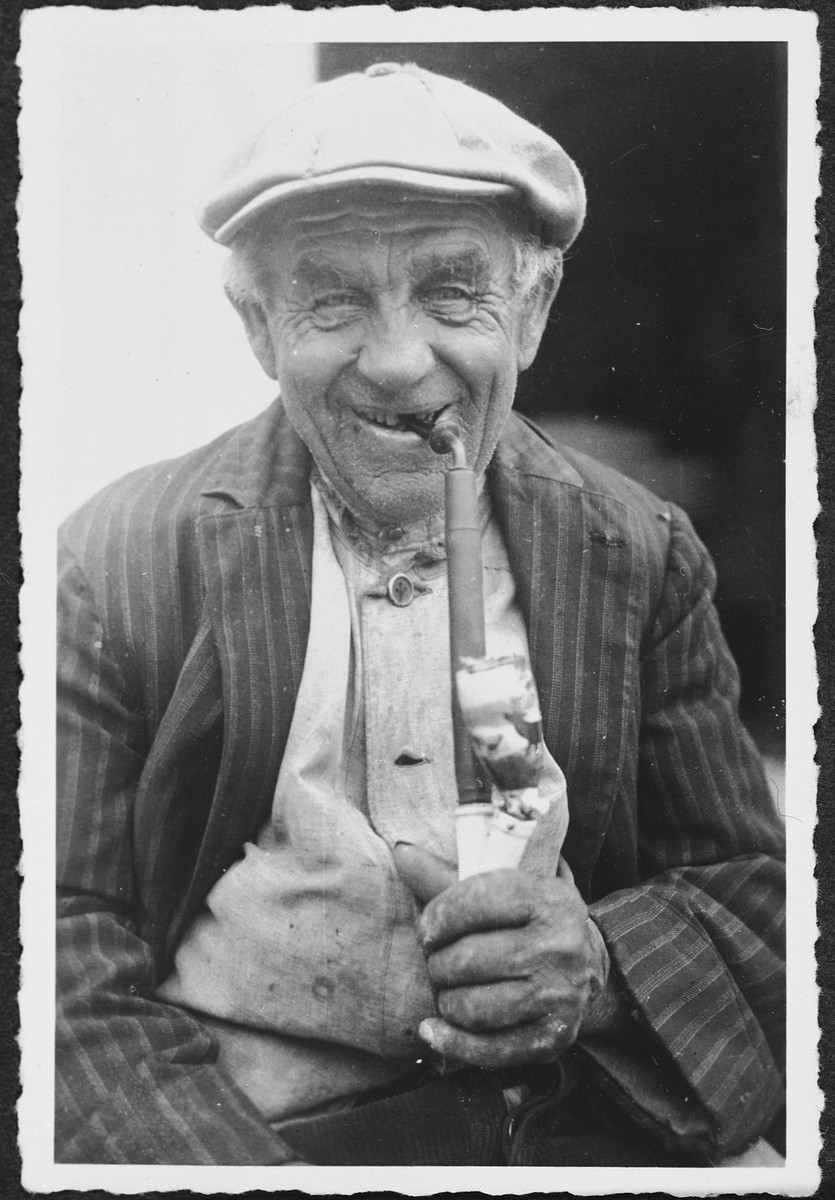 Close-up portrait of an elderly Jewish man in Rimpar smoking a pipe.