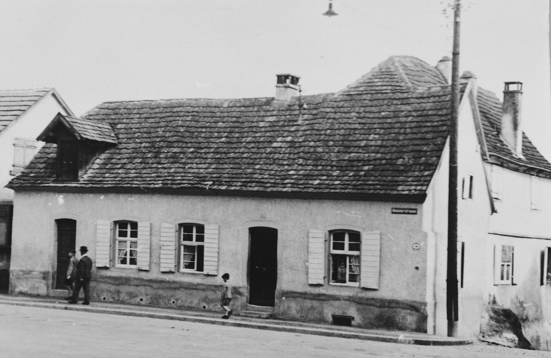Exterior view of the home of Raphael Bähr (the father of Hermann and Julius) on Judengasse in Breisach.    This house was one of five homes destroyed during the bombing of the town at the end of the war.  Most of the other Jewish homes were not destroyed.  This is part of series of photographs taken of the Breisach Jewish community 1937.  In October 1940 the entire community was deported to the Gurs internment camp in southern France.