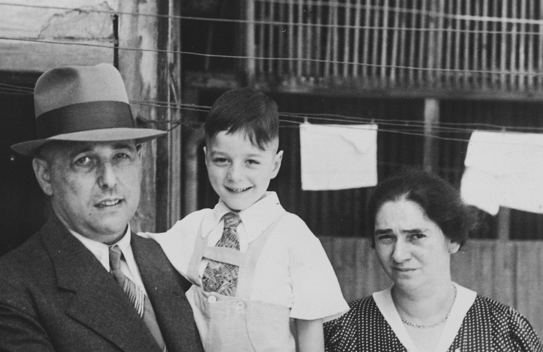 Close-up portrait of a Jewish family in Breisach, Germany.  Pictured are Hugo, Arno and Hulda Geismar.  Hulda was born on July 7, 1899.  Hugo was born in Breisach on March 27, 1890.  Arno was the last Jewish child to be born in Breisach in 1932.  The family escaped to the United States.  This is part of series of photographs taken of the Breisach Jewish community on their way to and from synagogue in 1937.  In October 1940 the entire community was deported to the Gurs internment camp in southern France.