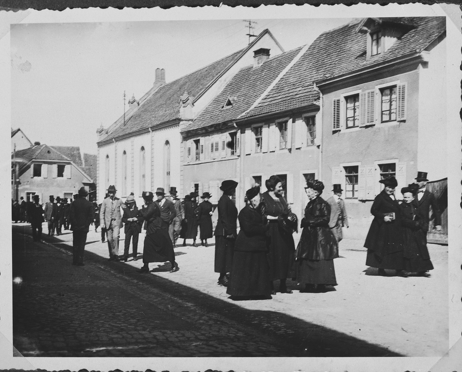 German Jews congregate on the street outside the synagogue in Breisach after Saturday morning services.  Rosa Geismar (nee Uffenheimer) is third from the right.