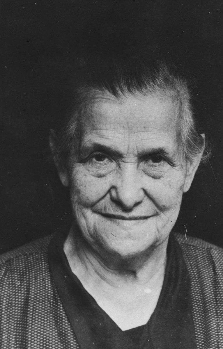 Close-up portrait of an elderly Jewish woman in Breisach, Germany.  Pictured is Emilie Geismar (nee Schnurmann).  She died in Breisach from natural causes.  This is part of series of photographs taken of the Breisach Jewish community on their way to and from synagogue in 1937.  In October 1940 the entire community was deported to the Gurs internment camp in southern France.