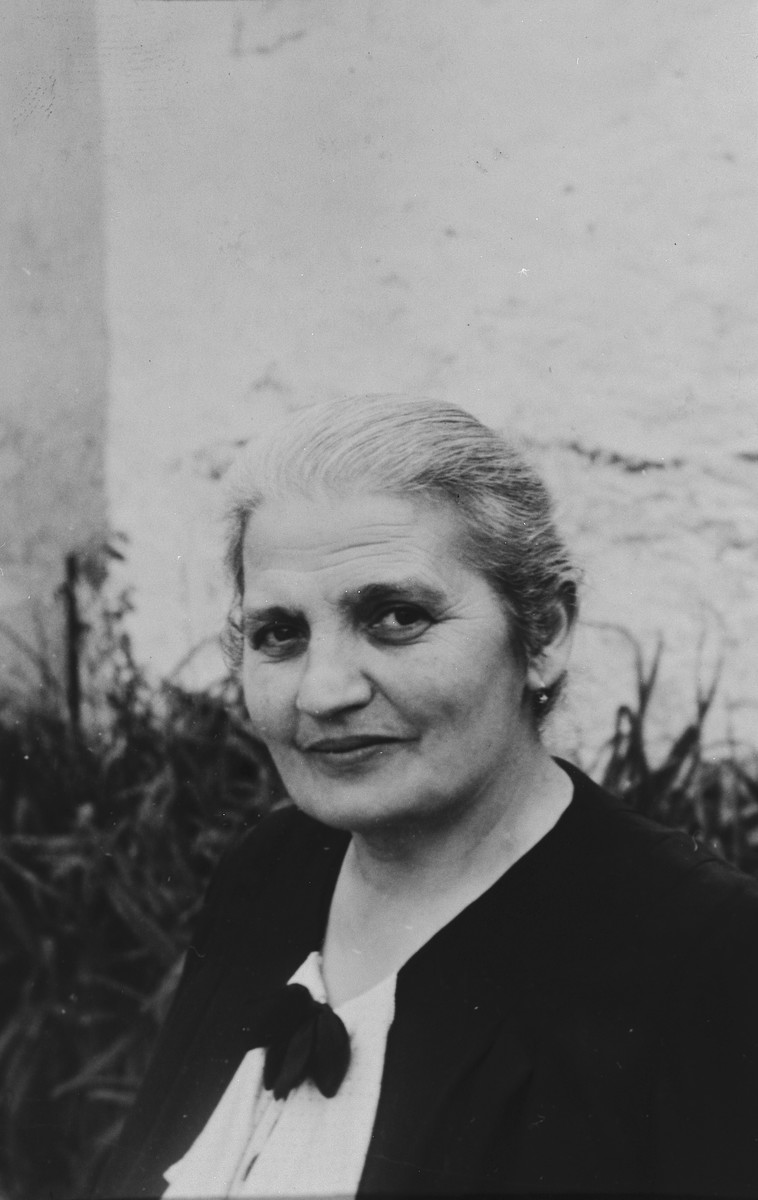 Close-up portrait of a Jewish woman in Breisach Germany.  Pictured is Rosa Geismar, nee Uffenheimer (b. 08/31/1879 in Breisach).  She was deported to Gurs, France on October 22, 1940 and from there was sent to Auschwitz on Convoy #17 in August 1942 where she perished along with her daughter Erna Maier and her grandson, Hans-Juergen Maier.  This is part of series of photographs taken of the Breisach Jewish community on their way to and from synagogue in 1937.  In October 1940 the entire community was deported to the Gurs internment camp in southern France.
