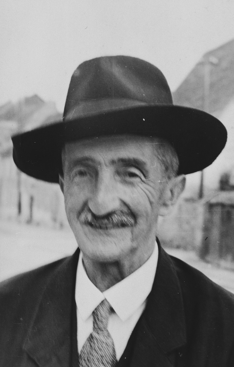 Close-up portrait of a Jewish man in Breisach, Germany.  Pictured is Ferdinand Geismar.  He was a cousin of the Baehrs.  He was born in Breisach on 11/16/1862 and died in the Jewish Home for the Elderly in Gailingen on 6/24/1939.  This is part of series of photographs taken of the Breisach Jewish community on their way to and from synagogue in 1937.  In October 1940 the entire community was deported to the Gurs internment camp in southern France.