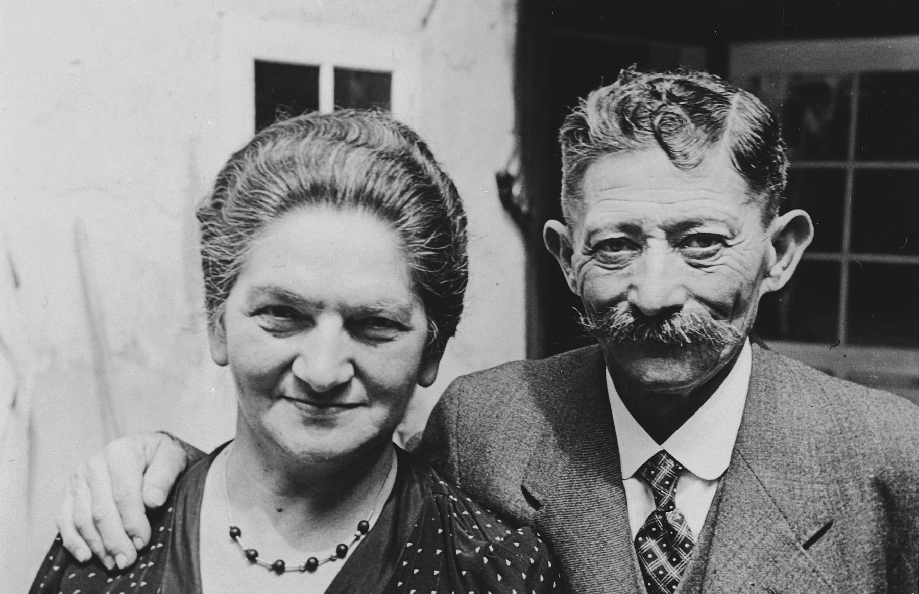 Close-up portrait of a Jewish couple in Breisach Germany.  Pictured are Josephine Geismar Dreyfus and Leopold Dreyfus who later immigrated to the United States.  This is part of series of photographs taken of the Breisach Jewish community on their way to and from synagogue in 1937.  In October 1940 the entire community was deported to the Gurs internment camp in southern France.