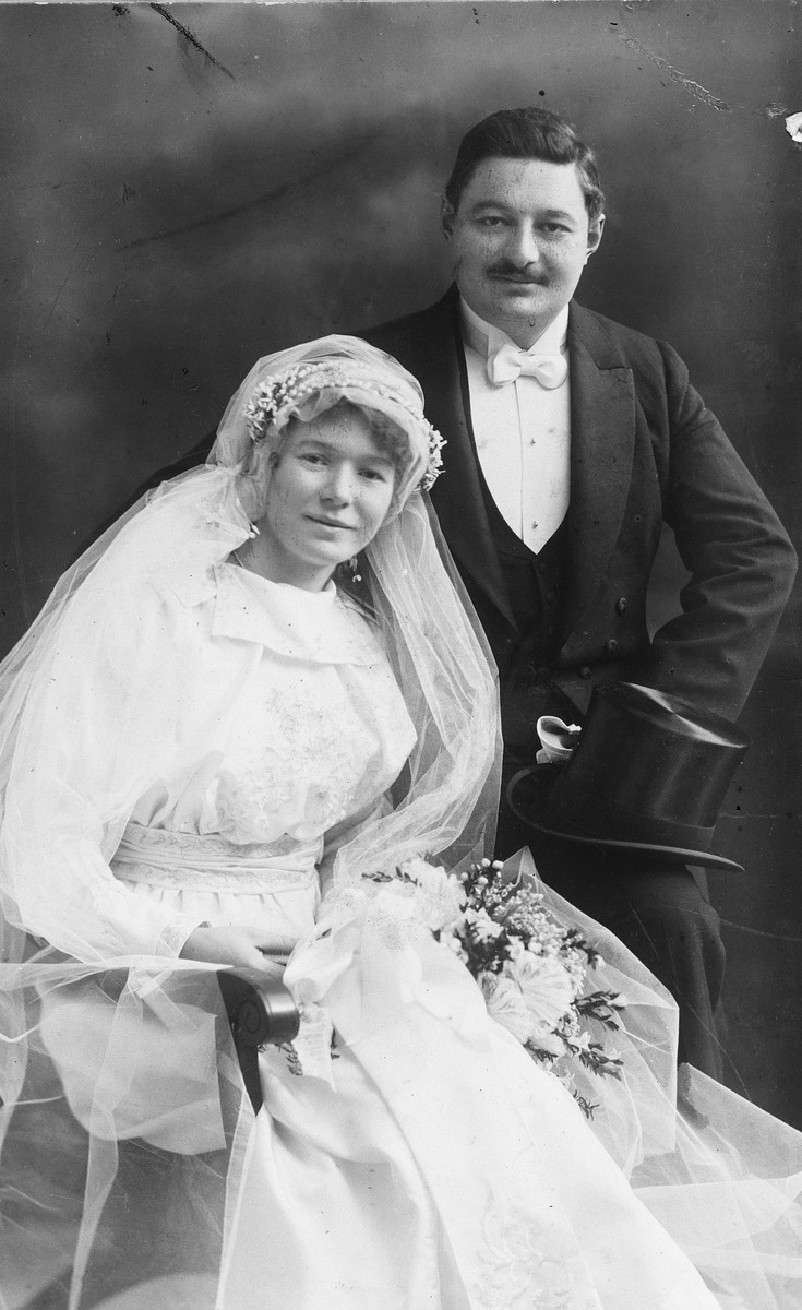 Studio wedding portrait of a Hungarian-Jewish couple.  Pictured are Zoltan Fisch and Iren Manheim.