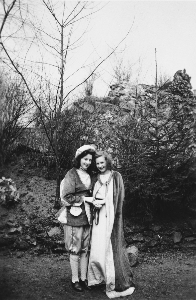 Two teenage Jewish girls dress up in medieval costumes while in hiding in the Convent Saint Antoine de Padue.  Pictured on the left is Edith Knoll (later Arams).