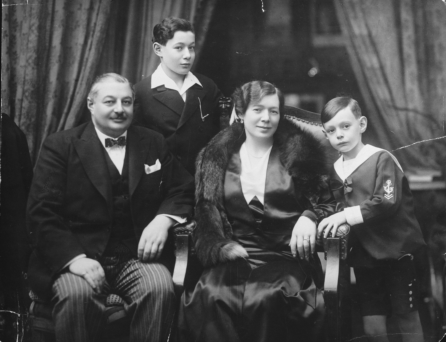 Studio portrait of a Hungarian-Jewish family.  Pictured from left to right are Zoltan, Paul, Iren and Robert Fisch.